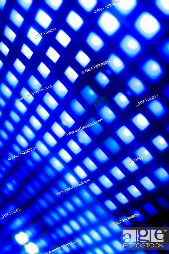 Stock Photo: Abstract grid of blue and white squares.