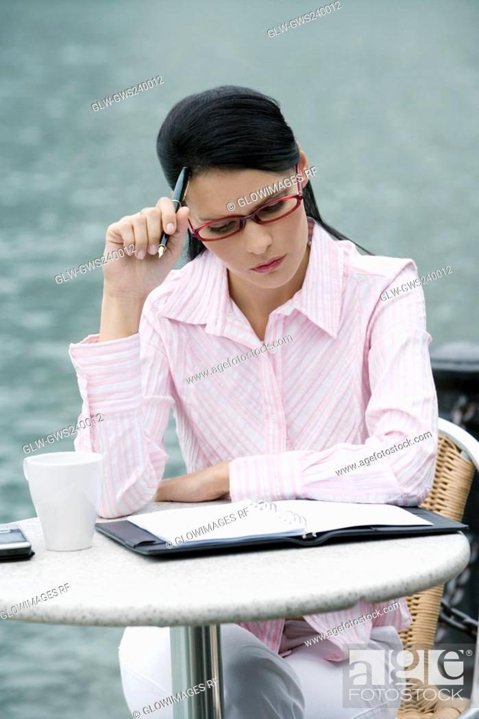 Stock Photo: Close-up of a businesswoman thinking.