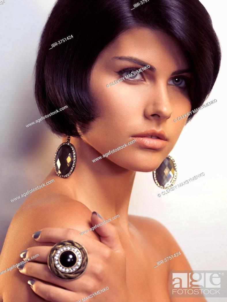 Stock Photo: Beauty portrait of a young glamorous woman wearing jewellery.