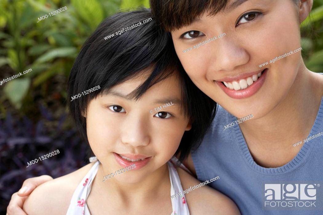 Stock Photo: Mother with daughter 7-9 close-up portrait.