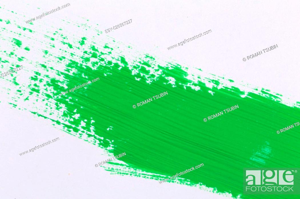 Stock Photo: green stroke of the paint brush on white paper.