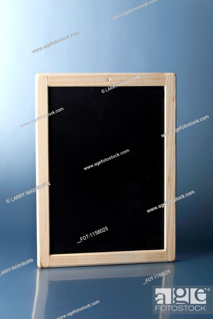 Stock Photo: A small blank chalkboard standing upright.