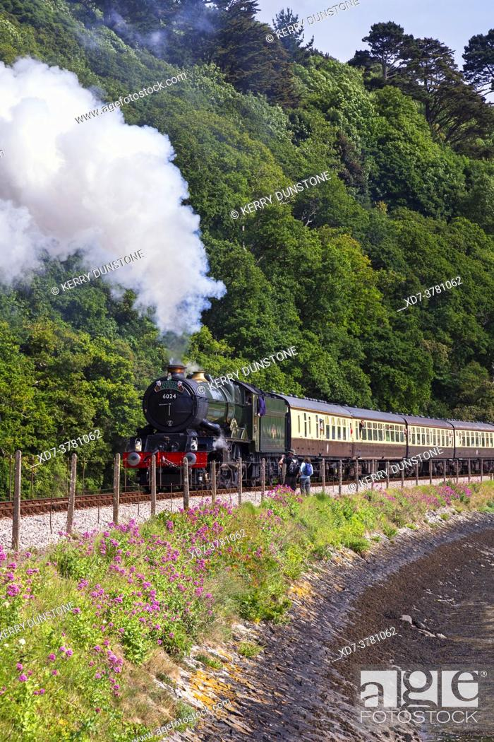 Stock Photo: England, Devon, GWR Steam Locomotive No. 6024 'King Edward I' departing from Kingswear heading the Torbay Express.