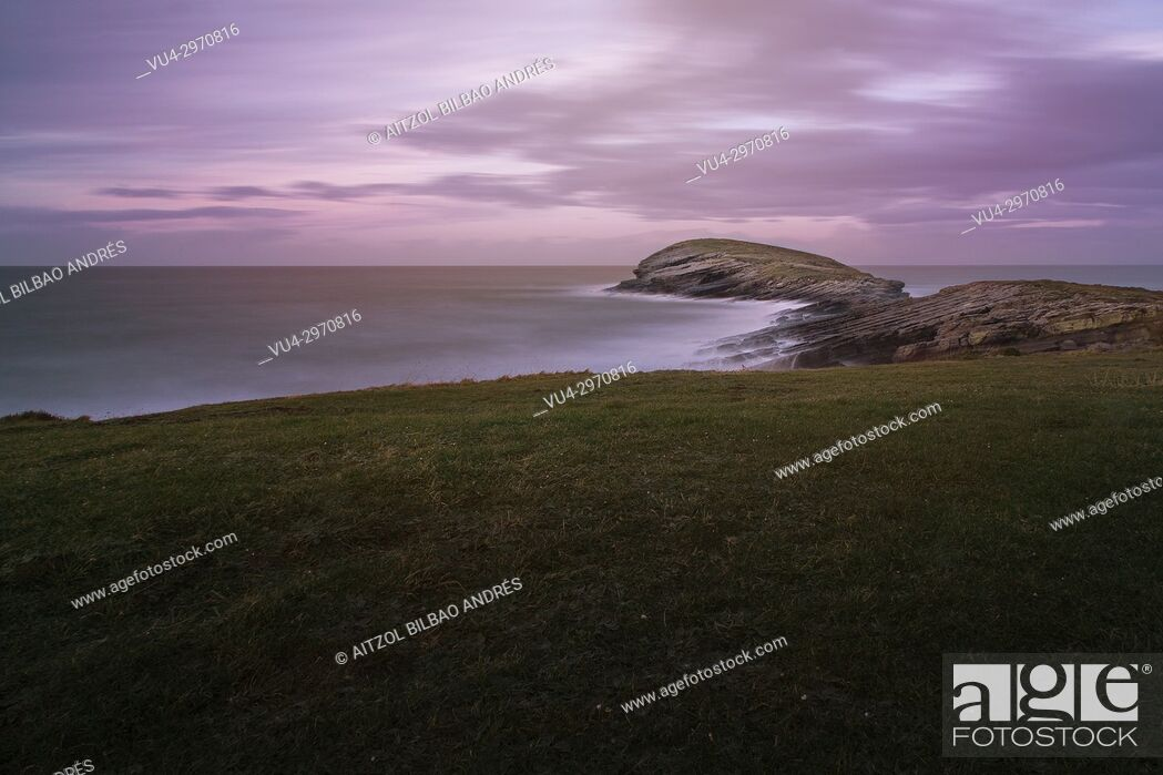 Stock Photo: The wale, a small island on the village of Sonabia, cantabria, spain. Long expo landscape.