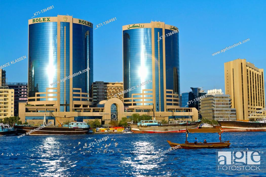 Stock Photo: The Dubai Creek skyline office towers with Dow boats in Dubai, UAE, Persian Gulf.