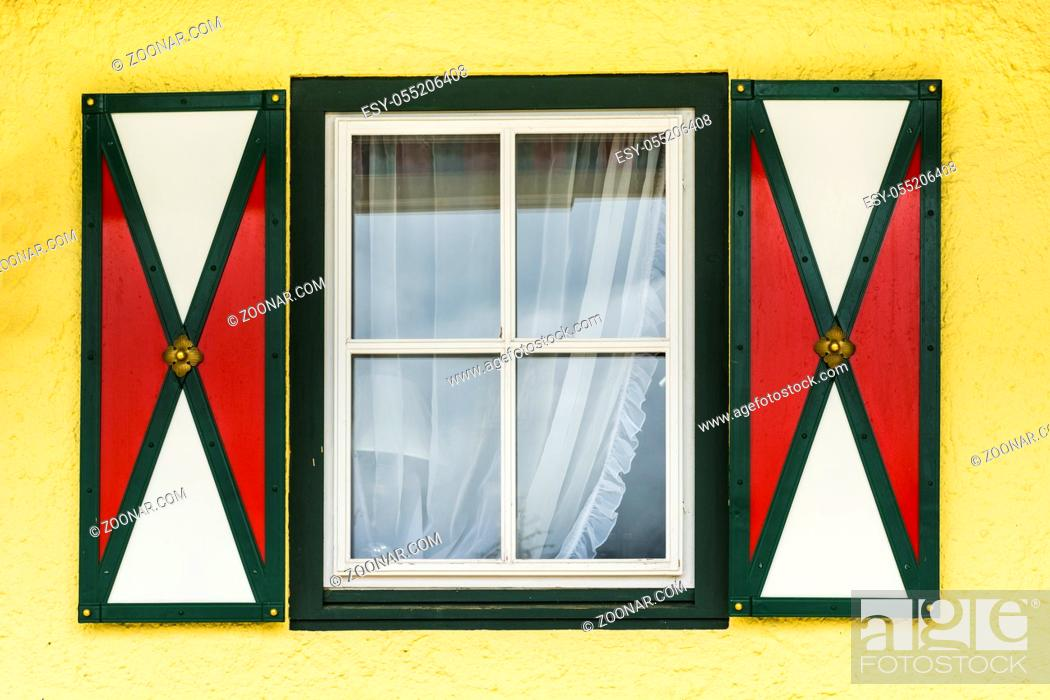 Stock Photo: Typical window of a house in a small town in Austria. Home in the Austrian city of St Wolfgang in a rainy day. Retro style.