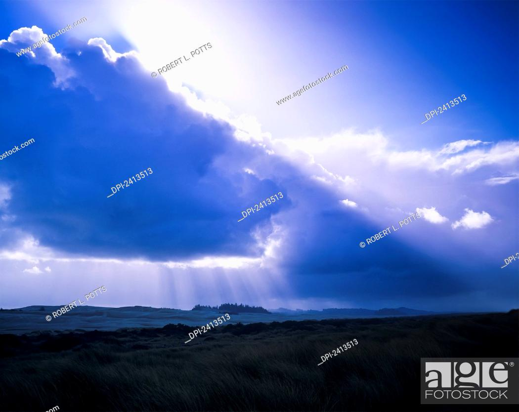 Stock Photo: Clouds diffuse the sunlight; Lakeside, Oregon, United States of America.
