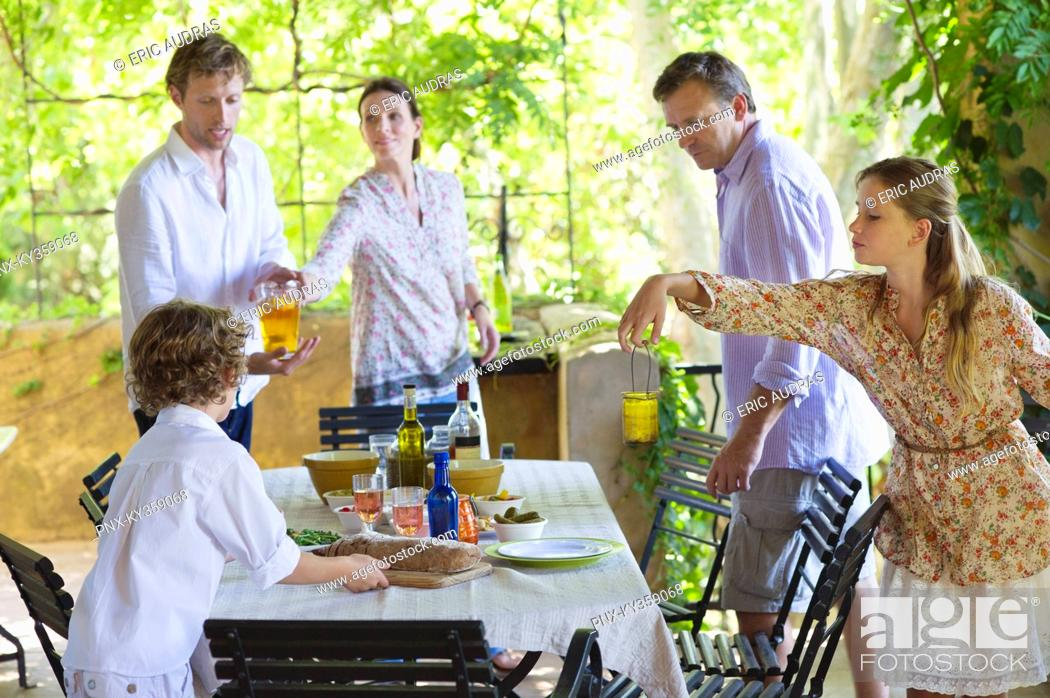 Stock Photo: Family preparing for food at house.