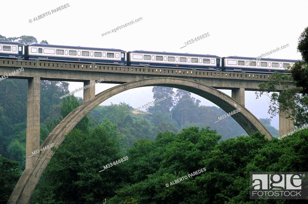 Stock Photo: Crossing a bridge in Luarca. Asturias. Transcantabrian train through the north of Spain.