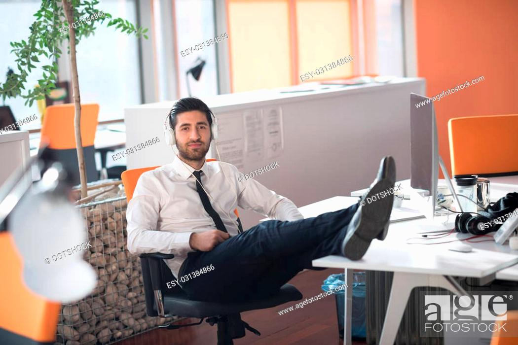 happy young arabian business man with beard listening music