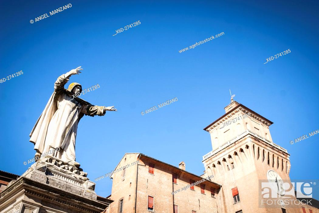 Stock Photo: View of Castle Estense or Castle of St Michael from Piazza Savonarola, with statue of monk in foreground, Ferrara.