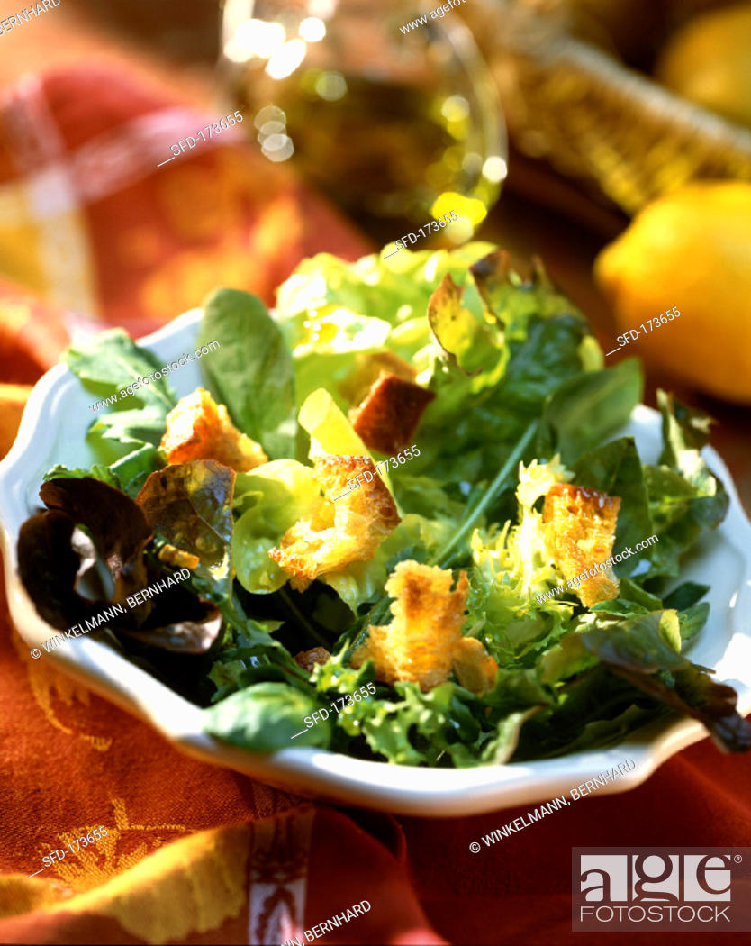 Stock Photo: Mixed salad leaves with croutons.