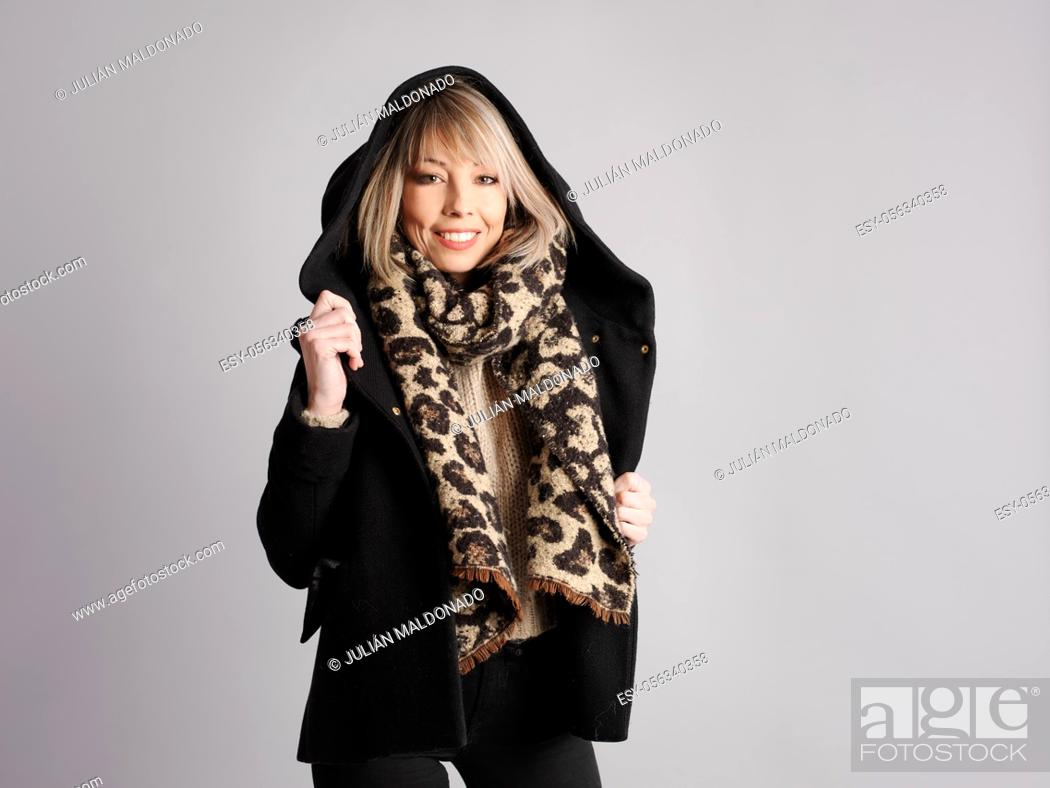 Stock Photo: Pretty young woman poses with cheerful and friendly winter and fitness clothes.