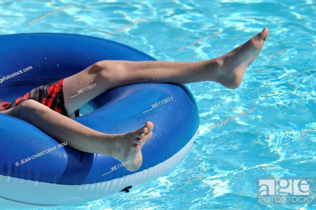 Stock Photo: Boy in swimming pool.