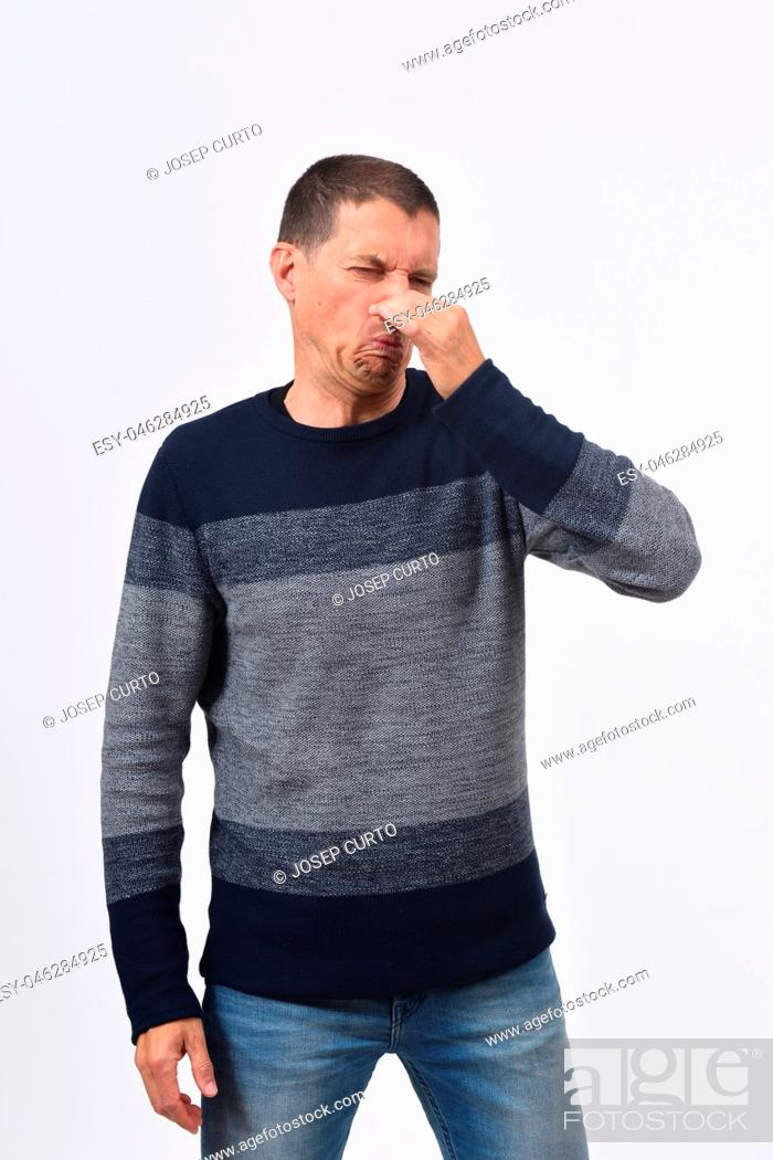 Stock Photo: man who covers his nose with his fingers because it makes an smell bad.