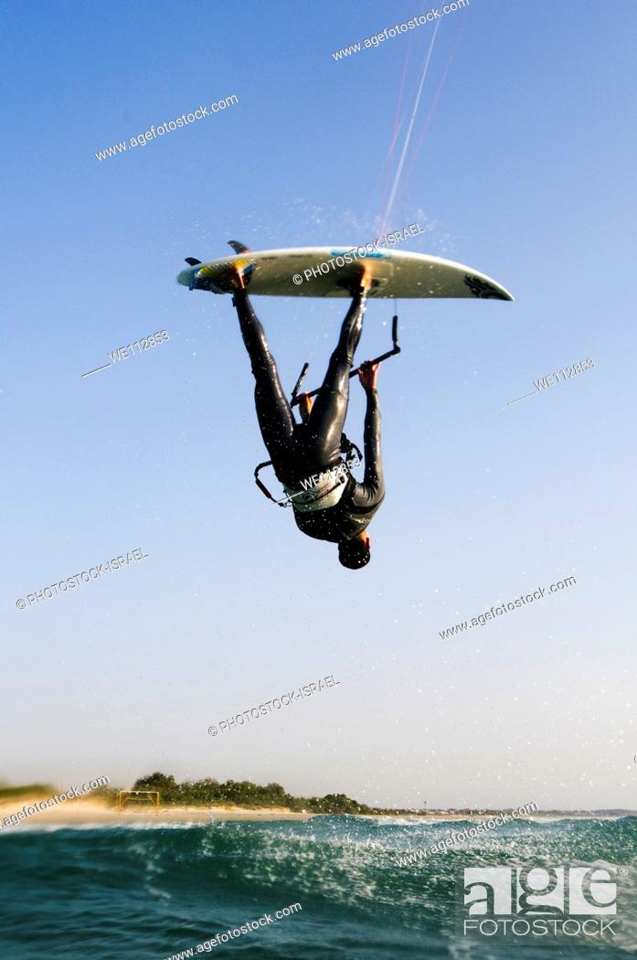 Stock Photo: Kitesurfing in the Mediterranean sea Photographed from within the water.