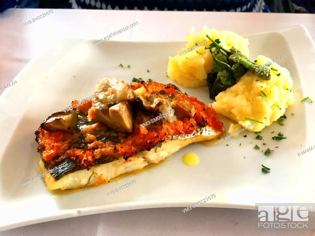 Stock Photo: Grilled fish loin with mushrooms, tomato, potato puree and green peppers.