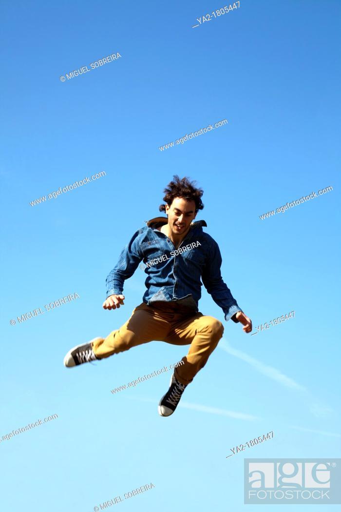 Stock Photo: Man Jumping Skywards.