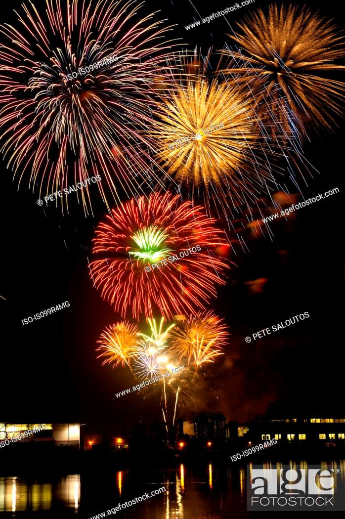 Stock Photo: Firework display over water.