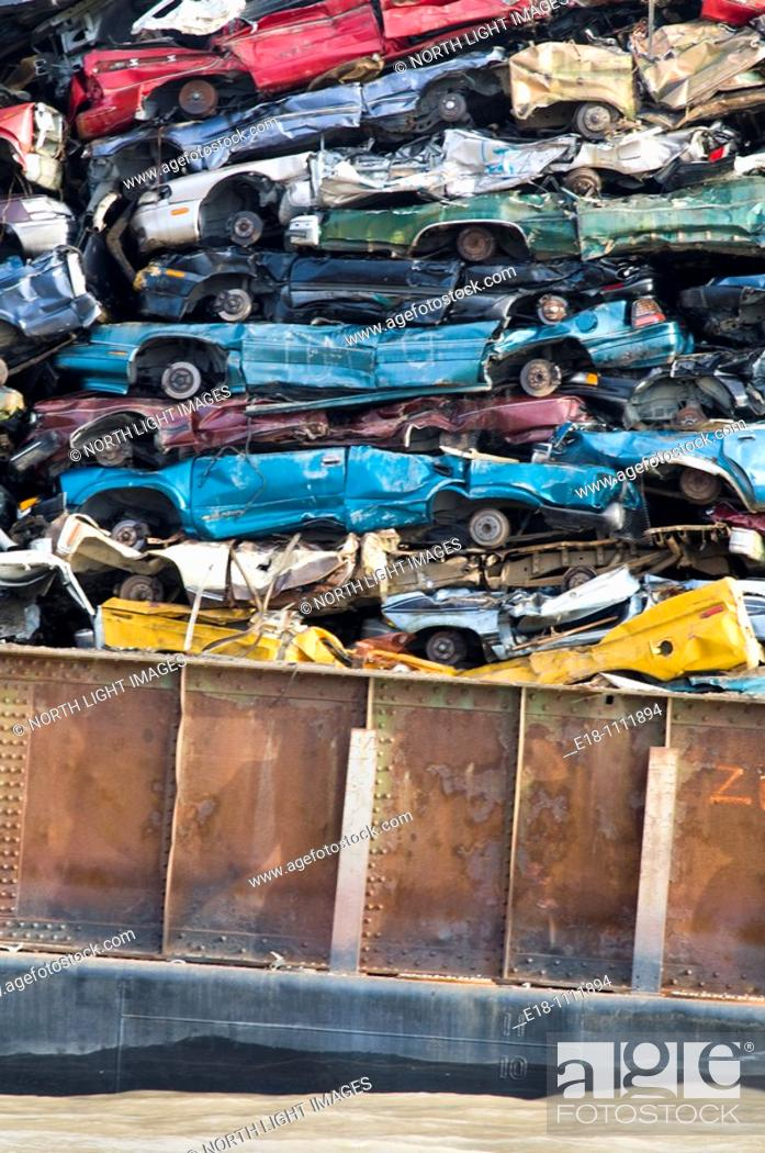 Stock Photo: Canada, BC, Barge loaded up with flattened automobiles  Going to scrap metal recycling yard.