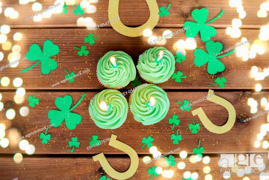 Stock Photo: green cupcakes, horseshoes and shamrock.