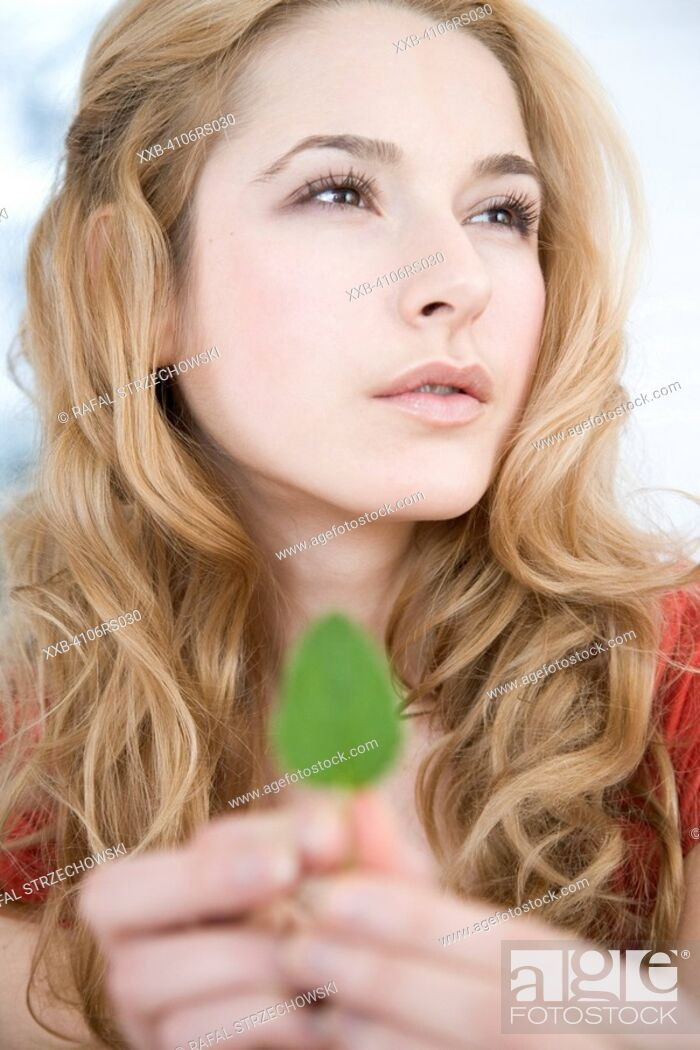 Stock Photo: young woman with mint leaf.