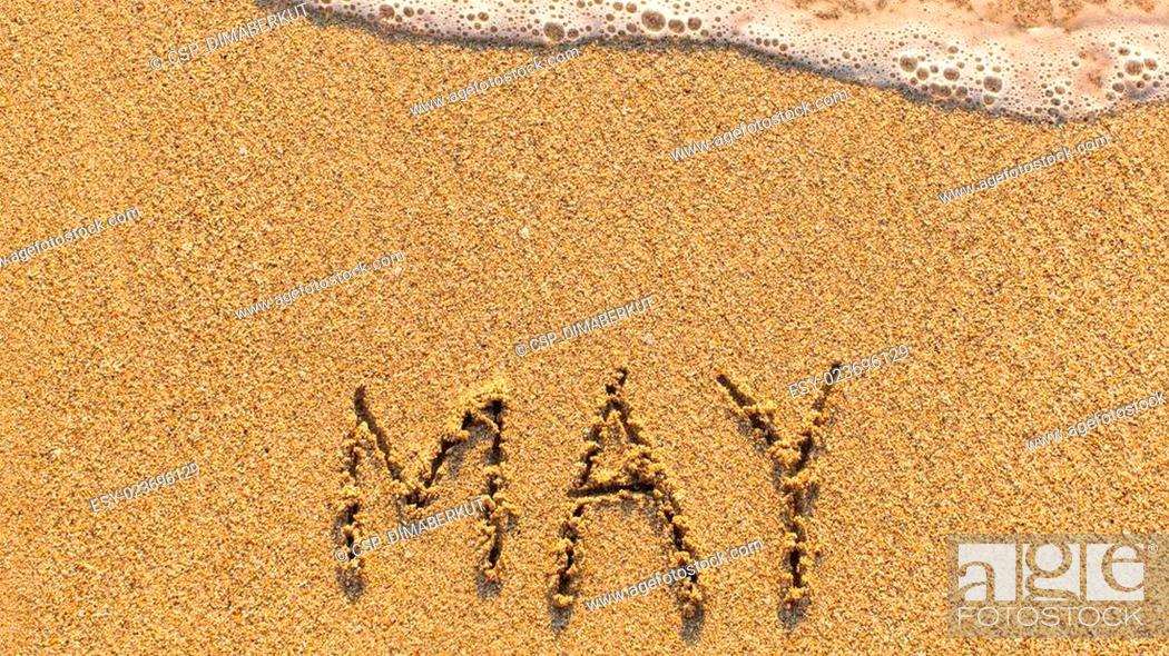 Stock Photo: MAY on a gentle beach sand.