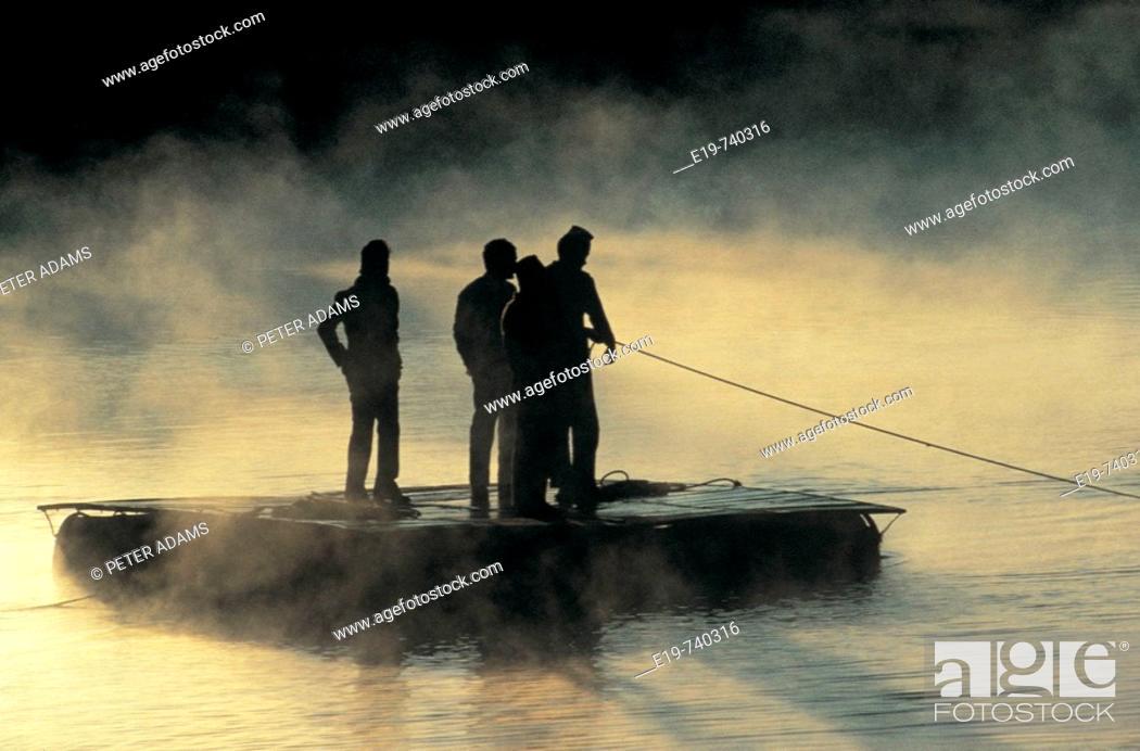 Stock Photo: Raft on misty river, Pokhara, Nepal.