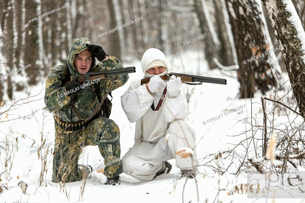 Stock Photo: Winter hunting in a camouflage suit. Belgorod region.