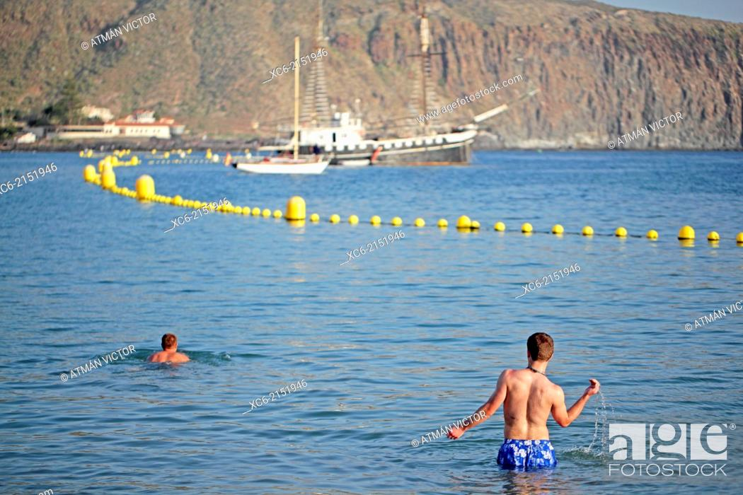 Stock Photo: two boys swimming at Los Cristianos beach in Tenerife island spain.