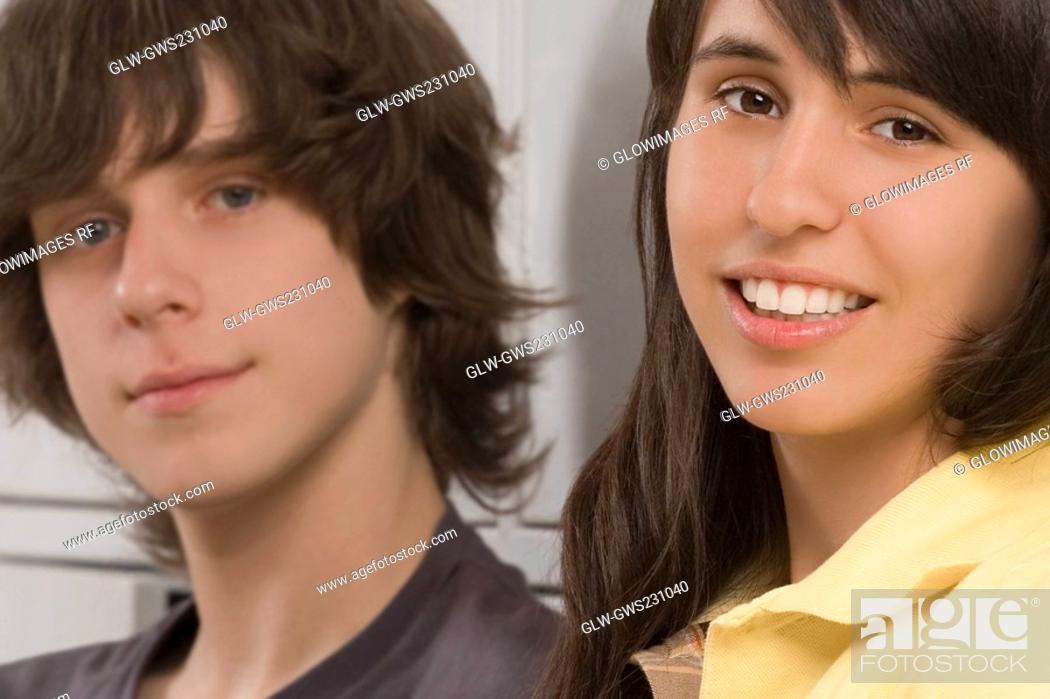 Stock Photo: Portrait of a teenage boy and a teenage girl smiling.