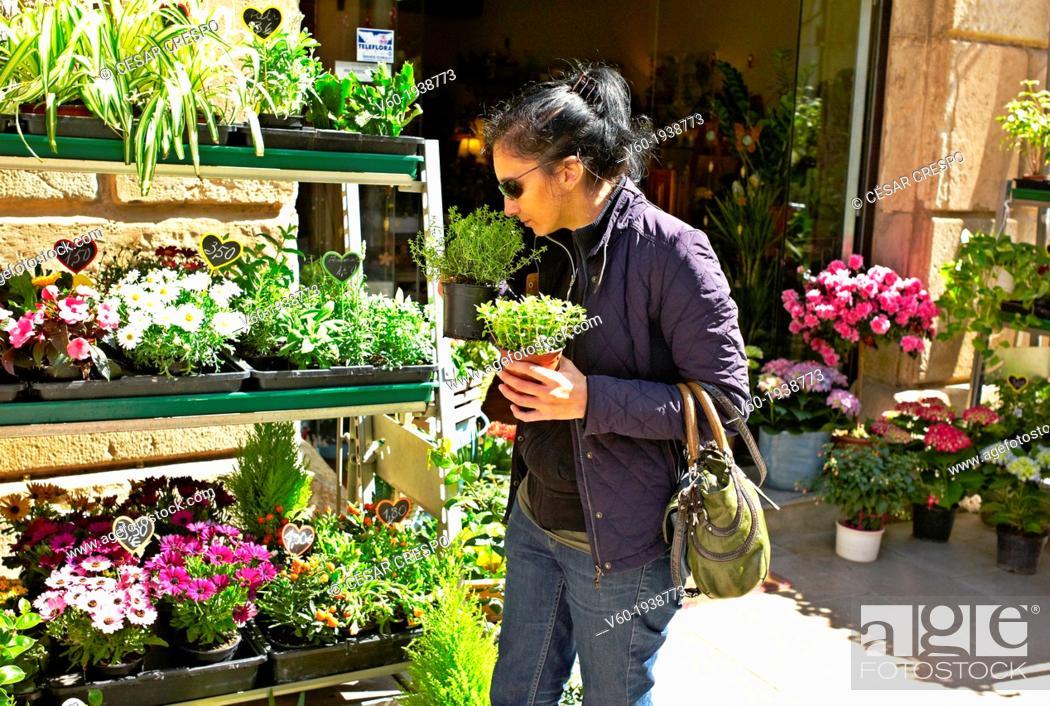 Stock Photo: -Woman Buying Plants- Gold Coast (Spain).