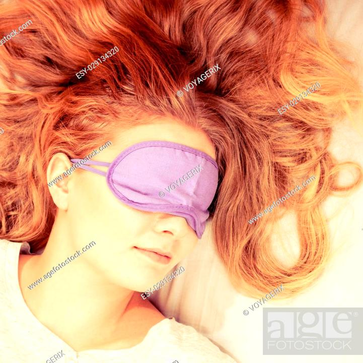 3bec5b3ac71 Stock Photo - Tired woman sleeping in bed wearing blindfold sleep mask. Young  girl taking nap. Instagram filtered.