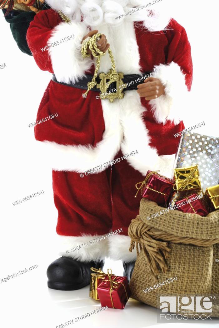 Stock Photo: Santa Claus Figurine with presents.