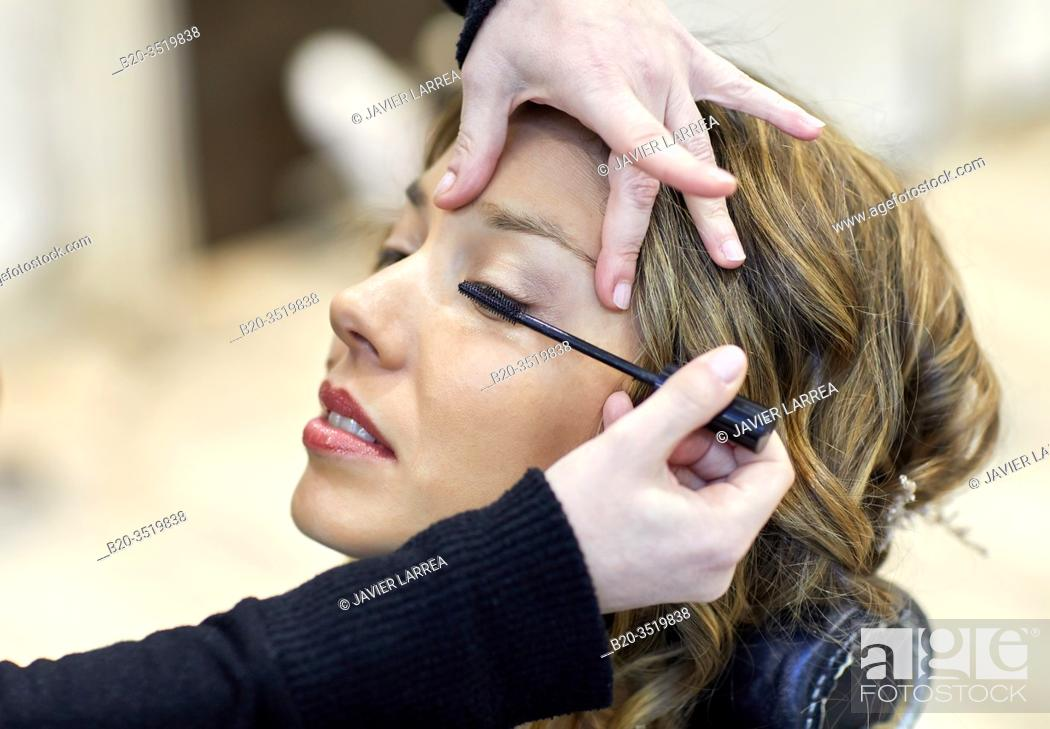 Stock Photo: Make-up artist putting on a woman's face, hairdressing salon and beauty clinic.