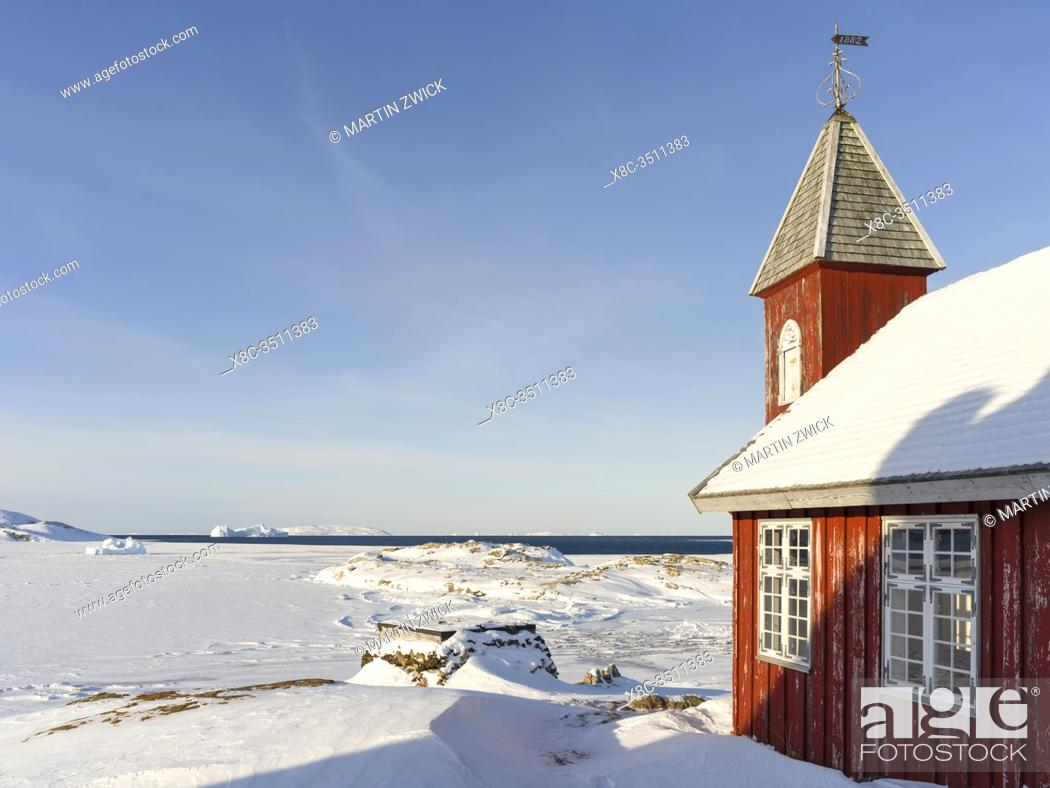 Stock Photo: Museum and church located in buildings dating back to the founding of the colony. Winter in the town of Upernavik in the north of Greenland at the shore of.