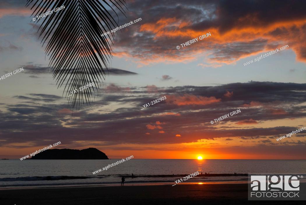 Stock Photo: Costa Rica. Pacific coast, Puntarenas province, Manuel Antonio, Playa Espadilla beach at sunset, back islas Gemelas, Latin America.