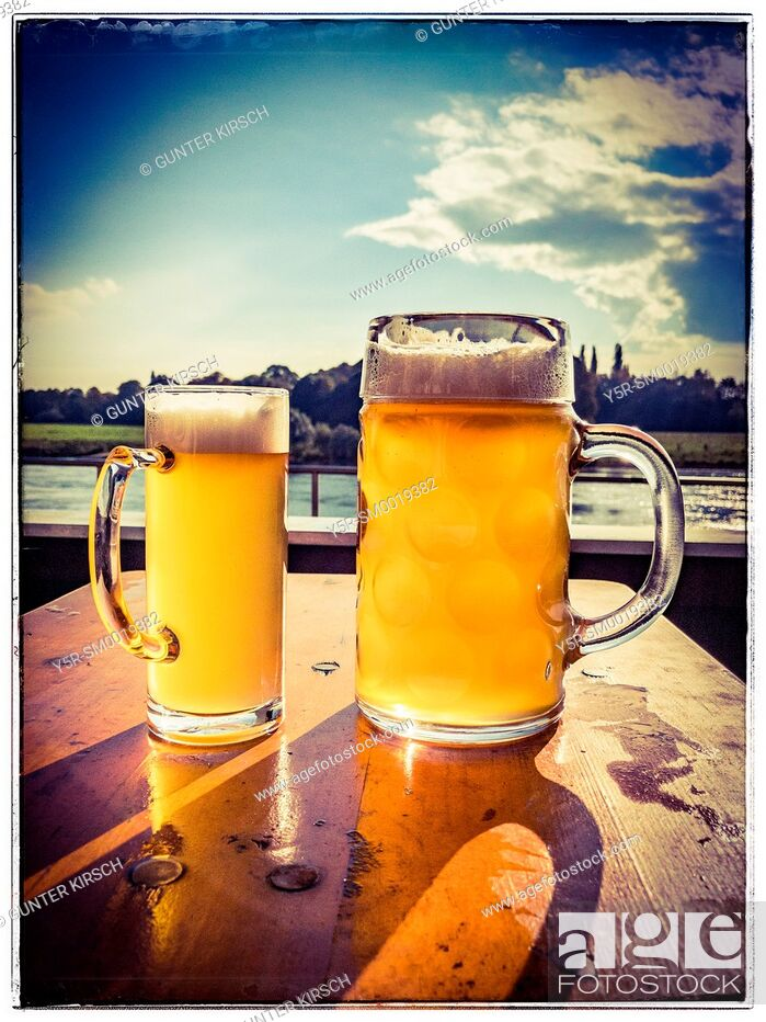 Stock Photo: A large and a small glass of Beer stand side by side.