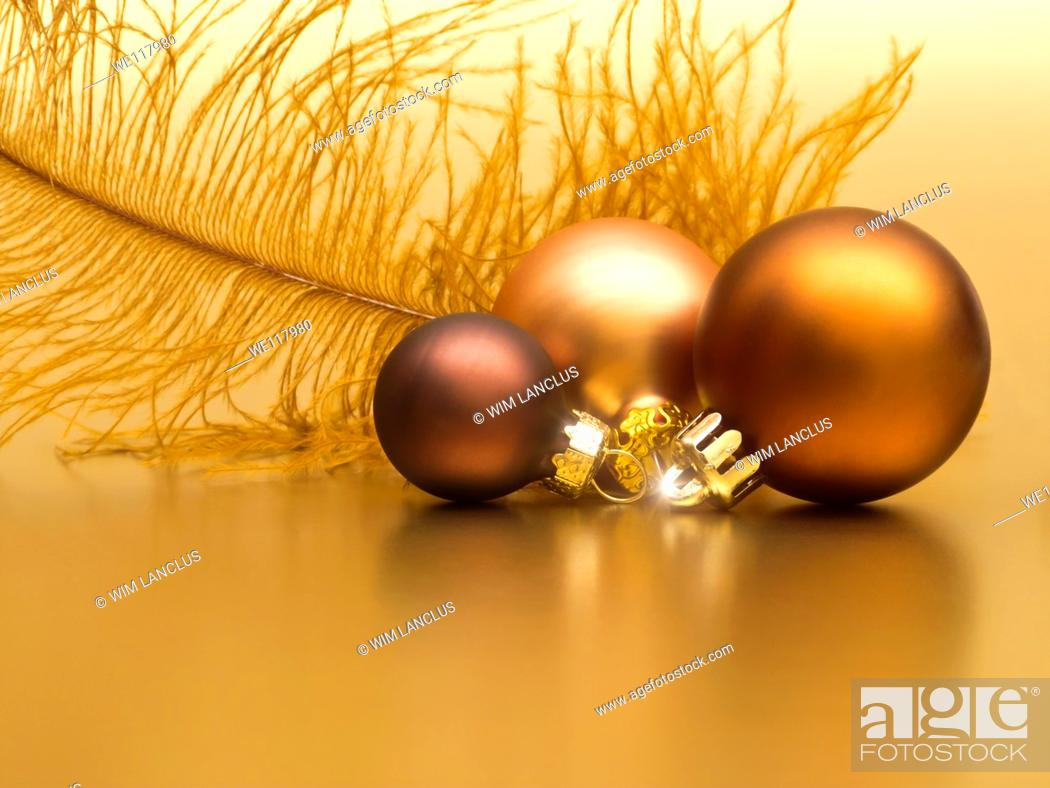 Stock Photo: Golden christmas decoration from baubles and feather.