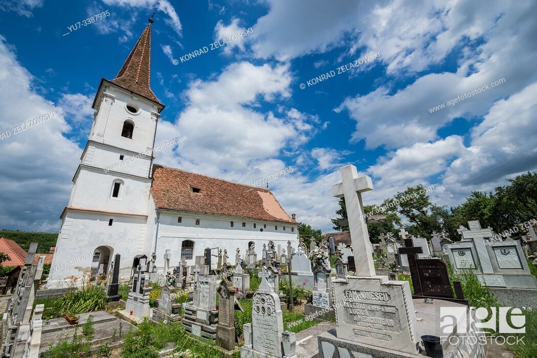 Stock Photo: Holy Trinity Church and cemetery in small village of Sibiel famous from traditional Saxon architecture in Saliste commune, Transylvania in Romania.