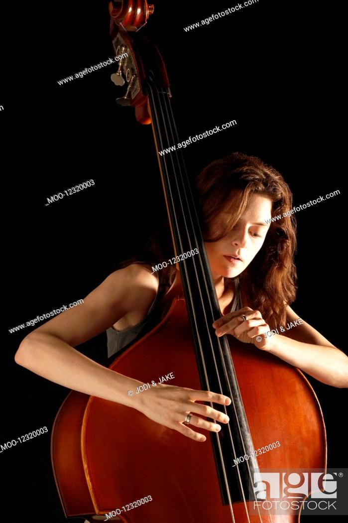 Stock Photo: Woman Playing Double Bass.