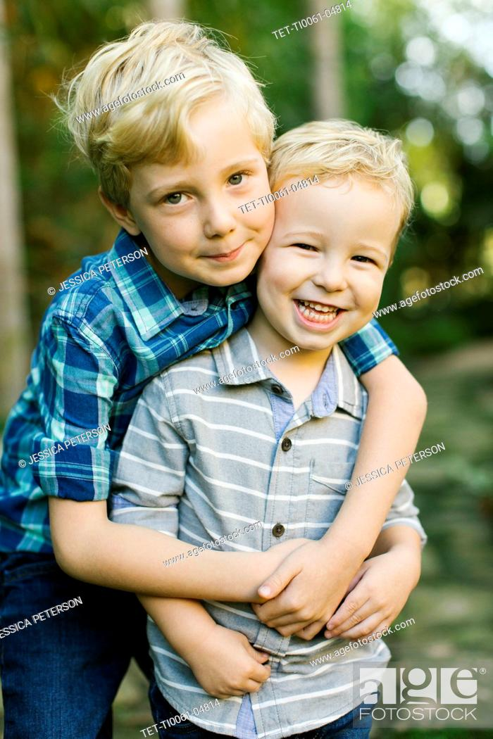 Stock Photo: Brothers hugging.