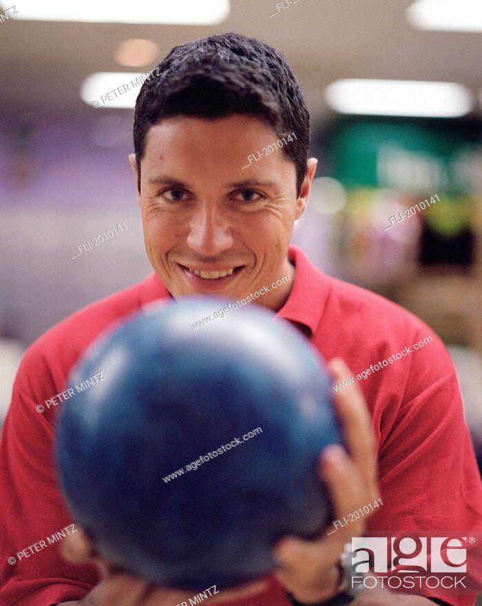 Stock Photo: Fv5440, Peter Mintz; Man Aiming Bowling Ball.