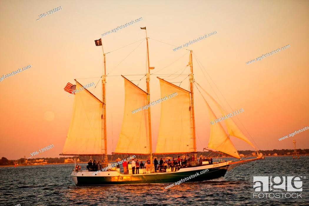 Stock Photo: Schooner Pride sunset cruise of the harbor in Charleston, SC.