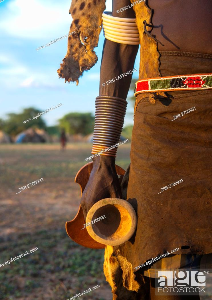 Stock Photo: Ethiopia, Omo Valley, Omorate, dassanech man with his wooden pillow during dimi ceremony to celebrate circumcision of the teenagers.