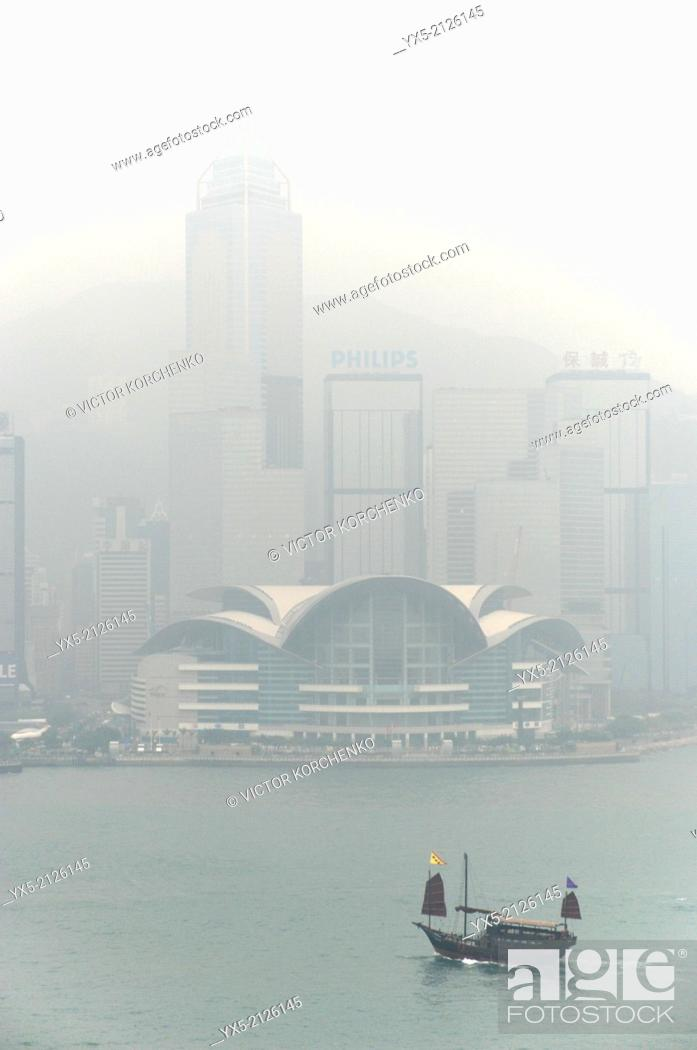 Stock Photo: Convention Centre and Victoria harbour in the morning fog, Hong Kong.