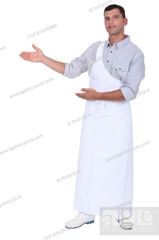 Imagen: Butcher gesturing to blank copy space.