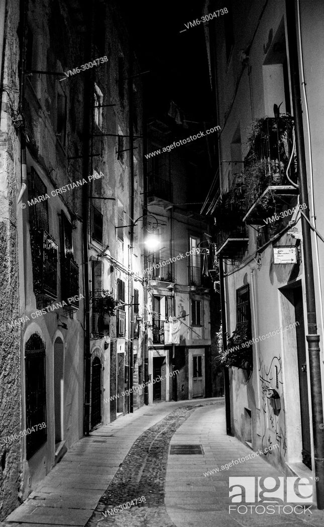 Stock Photo: a narrow cobbled street in the ancient quarter of Castello in Cagliaria, Sardinia Italy.