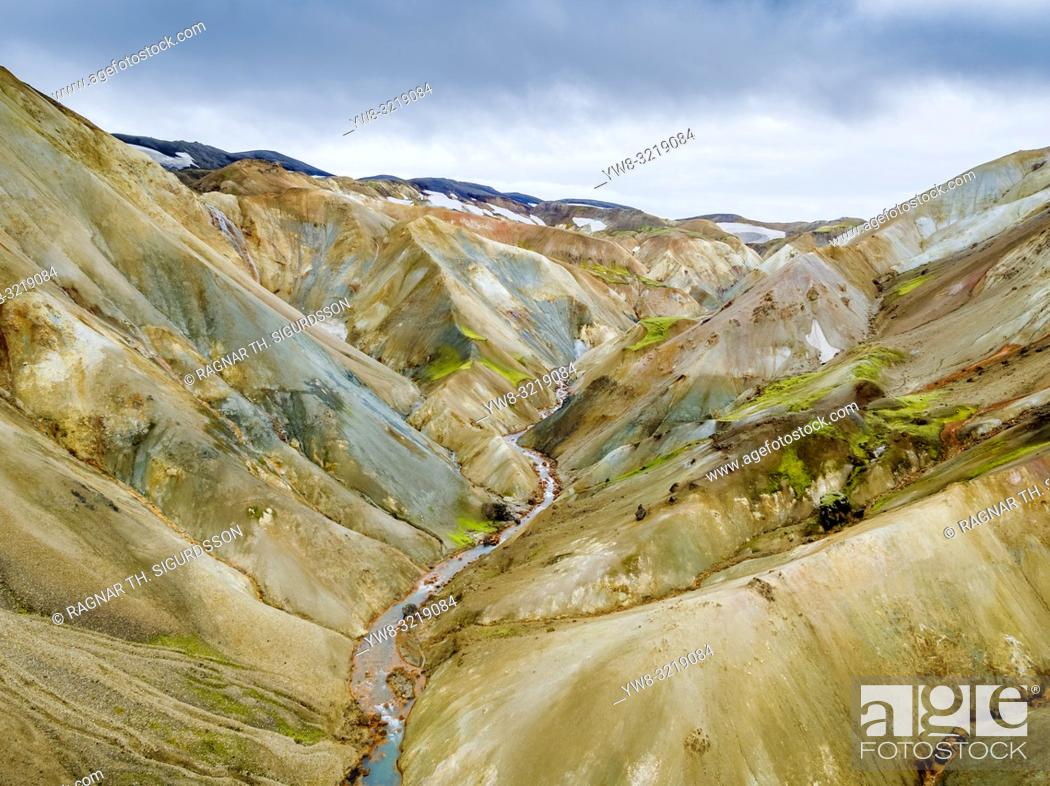 Stock Photo: Aerial-Jokulgilskvisl River and Mountain Peaks, Landmannalaugar, Iceland. The area is known for unusual geological elements such as multi-colored rhyolite.