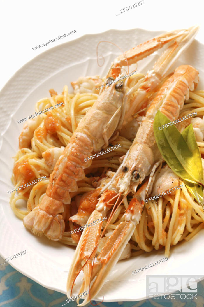 Stock Photo: Spaghetti with scampi and tomato sauce.